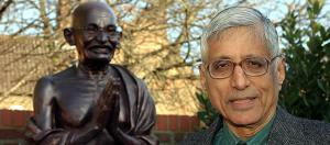 Rajmohan Gandhi with bust of his grandfather